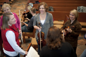 BSO musicians chat during a rehearsal break