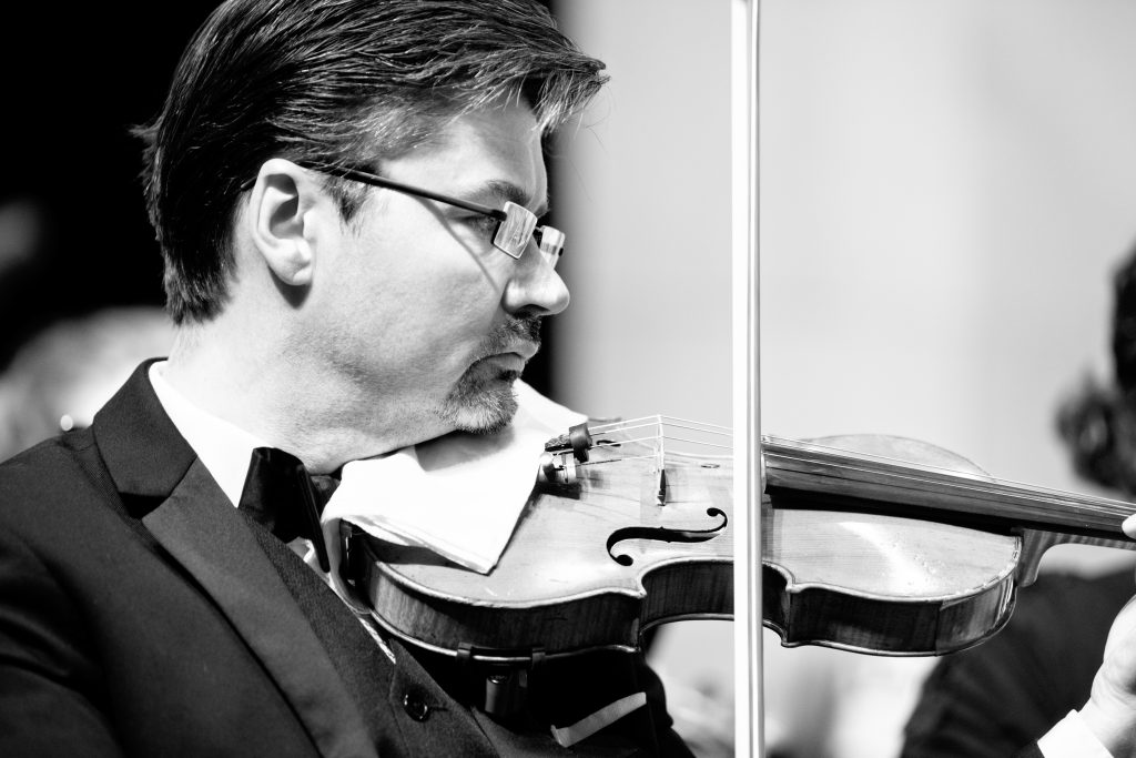 Violinist Michael Sutton plays in this black and white photograph